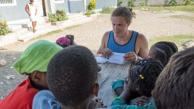 A Concordia student works with students in Haiti